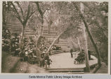 Thanksgiving service gathering at amphitheater under the oaks and sycamores at the Institute Camp,...