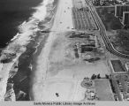 Looking north from the remains of the Pacific Ocean Park Pier to beach parking lots and the Santa...