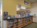 Low shelves with the DVD alcove in the background in the Fairview Branch Library (2101 Ocean Park...