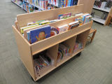 Cart of children's books in the Fairview Branch Library (2101 Ocean Park Blvd.), May 2, 2014,...
